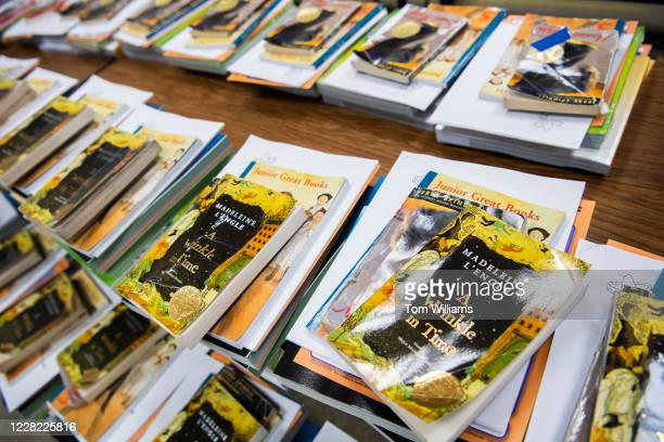 Books and supplies are arranged for parents to pick up for distance learning during a materials distribution at Heather Hills Elementary School in...
