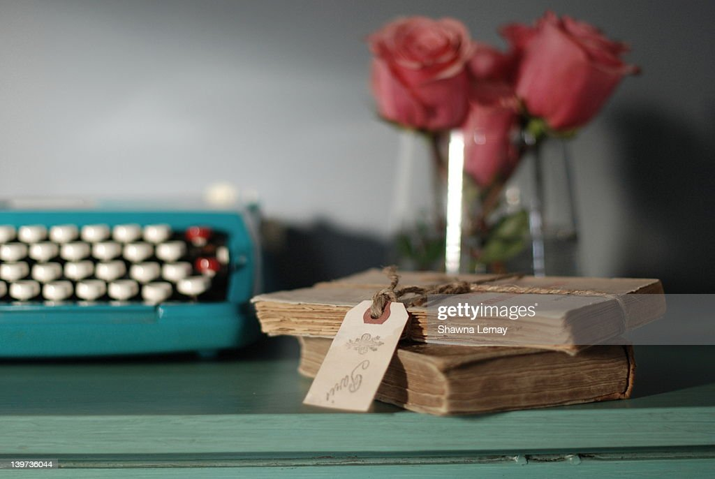 Books and typewritter : Stock Photo