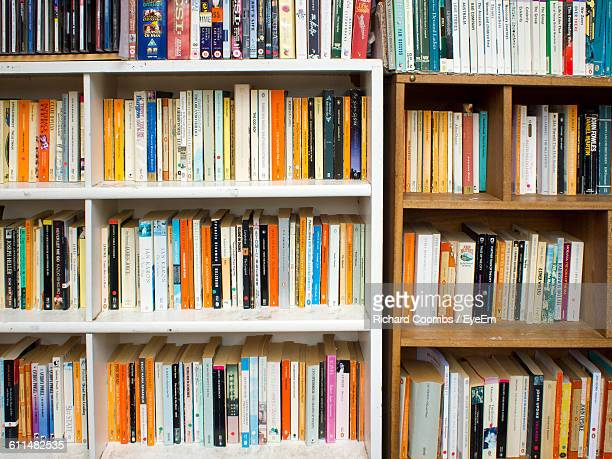 Books Arranged On Shelf At Library