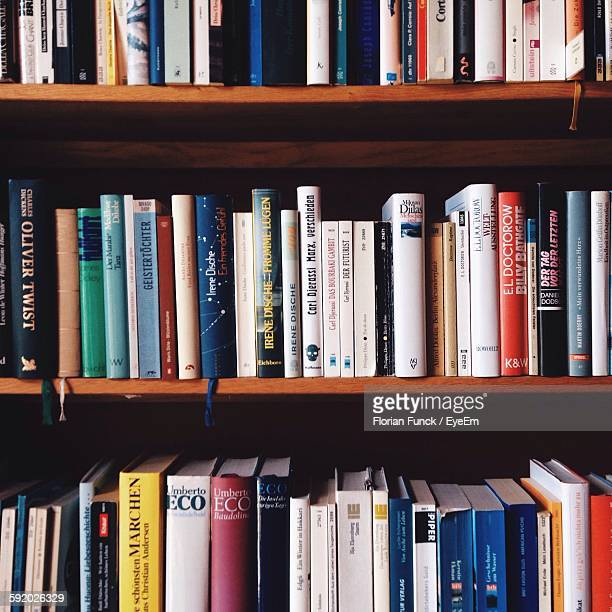 Books Arranging On Bookshelf