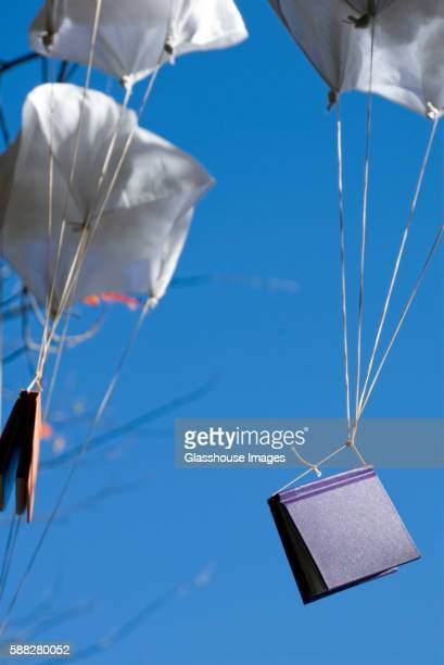 Books Attached to Small Parachutes