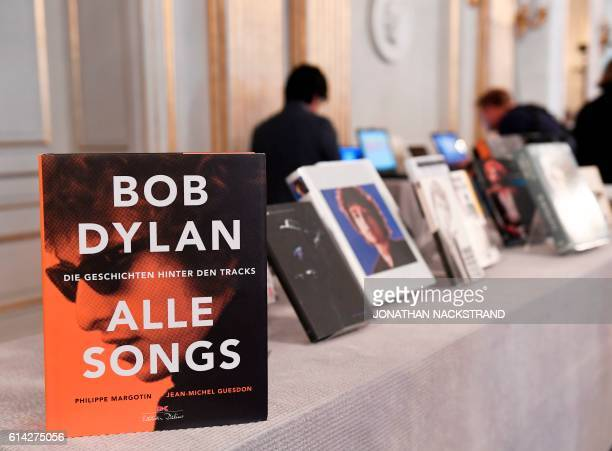 Books by US songwriter Bob Dylan who was announced the laureate of the 2016 Nobel Prize in Literature are displayed at the Swedish Academy in...