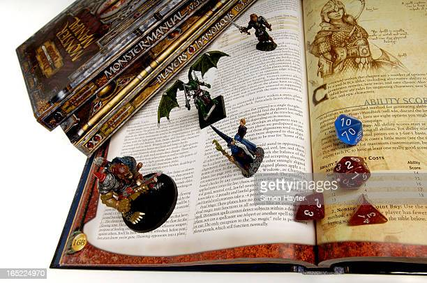 Books die figurines from Dungeons and Dragons to go with story on the game's creator Gary Gygax