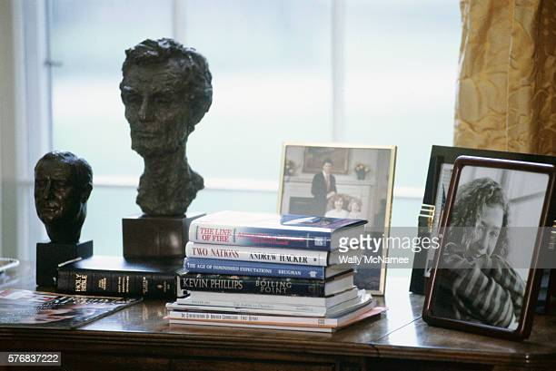 Books family portraits the Bible and portrait sculptures of past presidents are some of the items on President Clinton's desk in the Oval Office