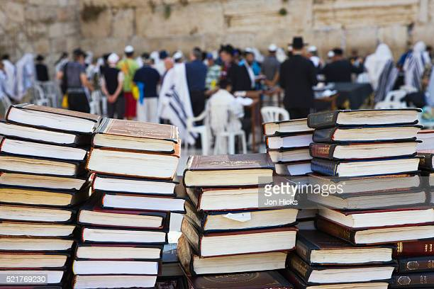 books for religious study at the western wall - judaism stock pictures, royalty-free photos & images