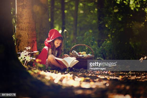 books help to expand a child's world and imagination - fairytale stock pictures, royalty-free photos & images