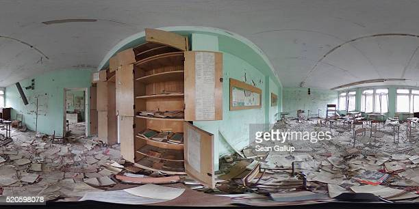 Books lie strewn across the floor in a former classroom in elementary school number three on April 9 2016 in Pripyat Ukraine Pripyat built in the...