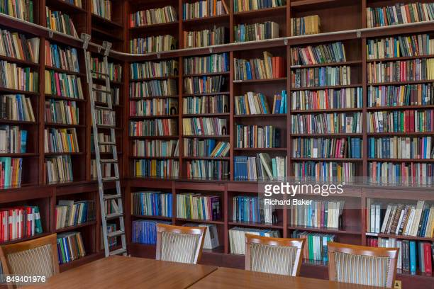 Books line the shelves in the Lee Library of the British Academy on 17th September 2017 at 1012 Carlton House Terrace in London England The British...