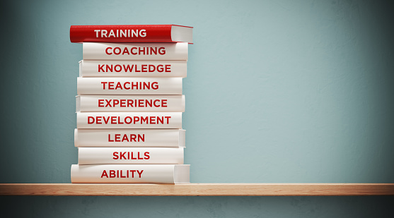 Books of  Training And Development In Front Grey Wall 1141314072