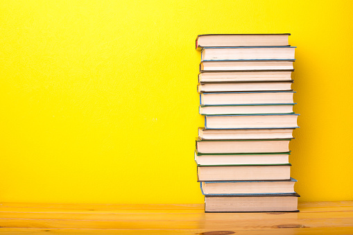 Books on a yellow background 960610662
