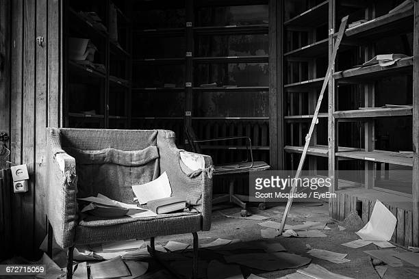 Books On Chair In Old Damaged Abandoned Library