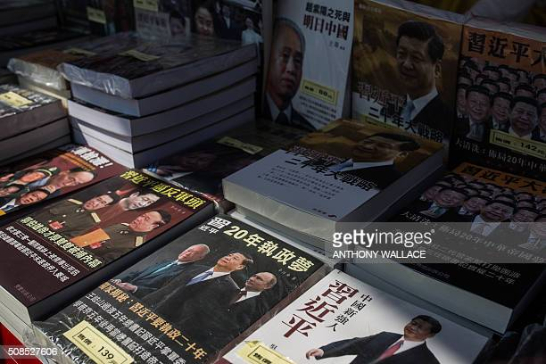 Books on Chinese politics supplied by Mighty Current the publisher which has seen five of its booksellers disappear are displayed at a stall set up...