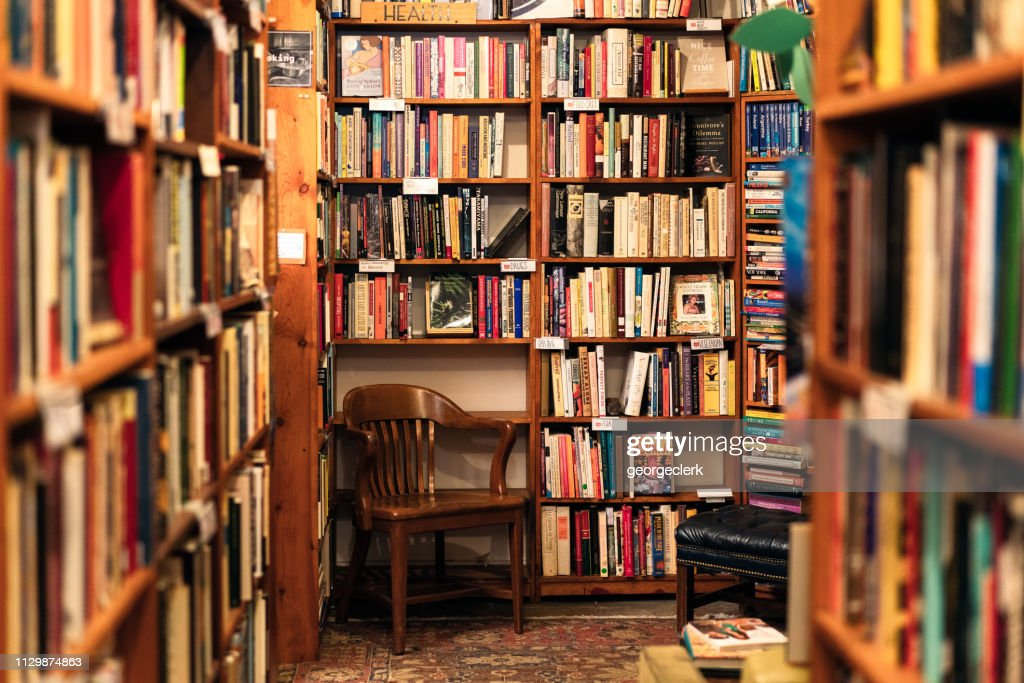 Books on display in the corner of a second hand bookstore : Stock Photo