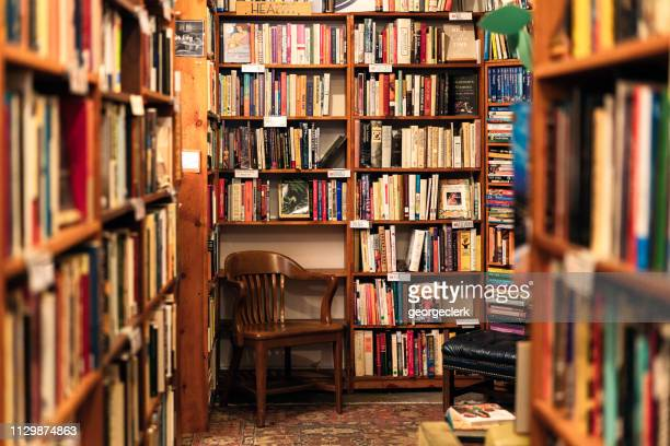 books on display in the corner of a second hand bookstore - the past stock pictures, royalty-free photos & images