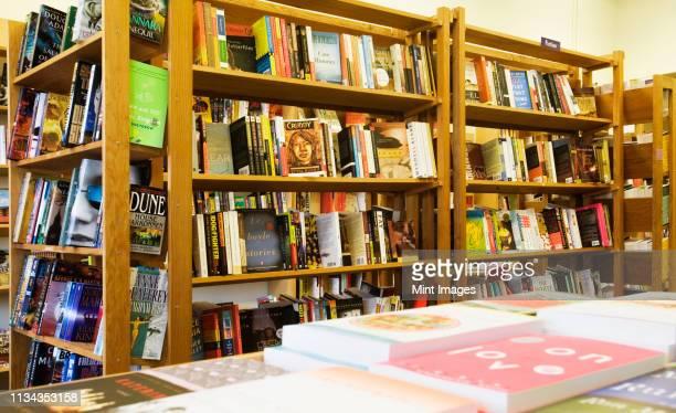 books on shelves in bookstore - 書店 ストックフォトと画像
