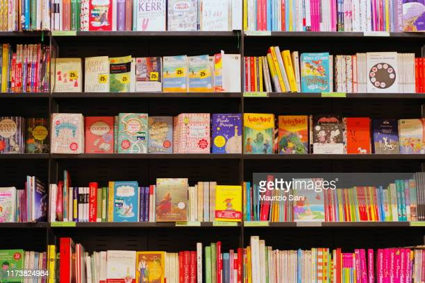 books on shelves in bookstore - picture book stock pictures, royalty-free photos & images