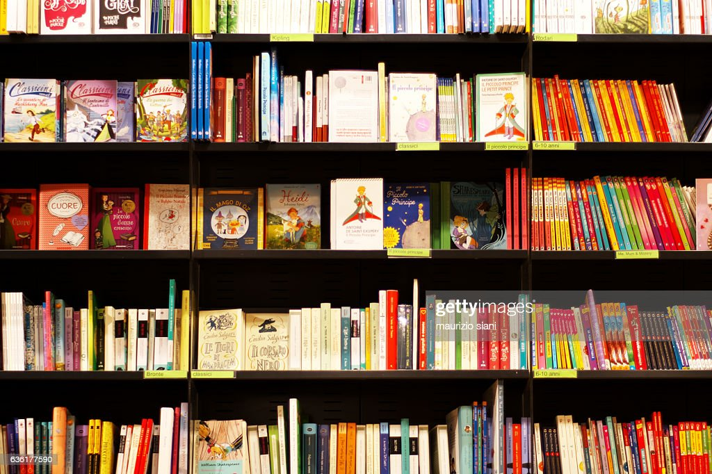Books on shelves in bookstore : Stock Photo