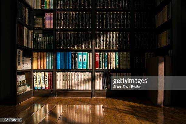books on shelves in library - library stock pictures, royalty-free photos & images