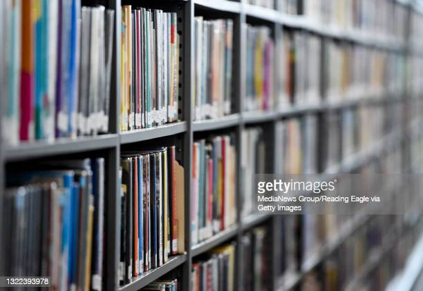 Books on shelves on the first floor at the library. At the Reading Public Library Main Branch on South 5th Street in Reading Monday morning June 7,...