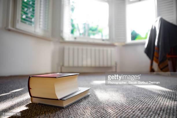 books on the carpet - basak gurbuz derman stock photos and pictures