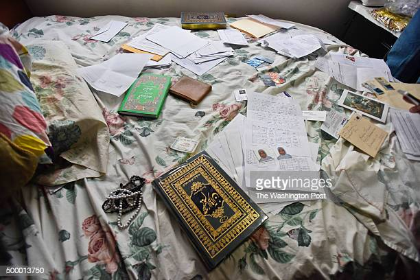 Books, personal effects, photos, and drivers license's on the bed at the home of the San Bernardino shooting suspects' home at 53 N Center St in...