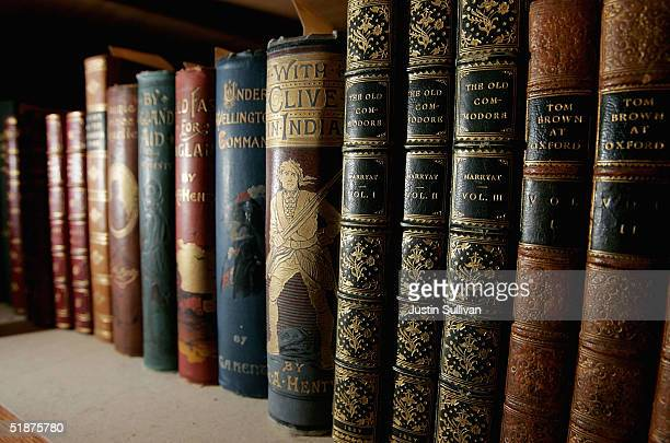 Books sit on a shelf at the Cecil H Green Library on the Stanford University Campus December 17 2004 in Stanford California Google the internet...