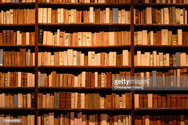 Books sit on shelves in the Duke Humphrey's Library at the Bodleian Libraries on August 25 2020 in Oxford England The world famous libraries closed...