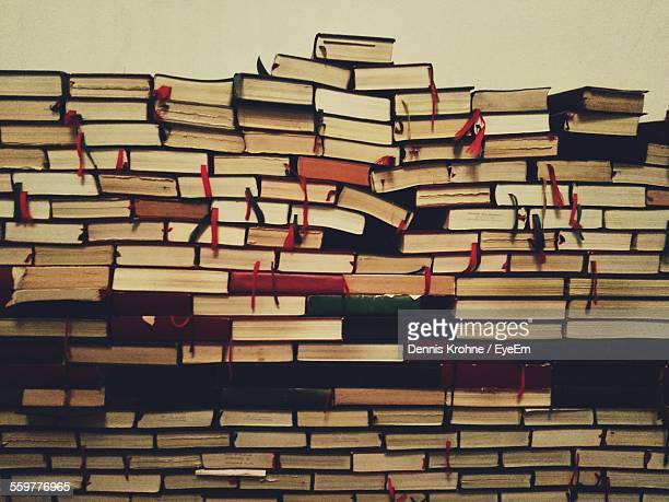 Books Stacked Against Wall