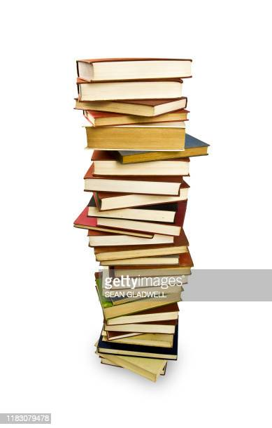 books stacked high - stack stock pictures, royalty-free photos & images