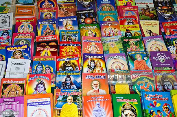 THIRUVANANTHAPURAM VARKALA KERALA INDIA Books with the religeous stories are sold at the local beach of Varkala