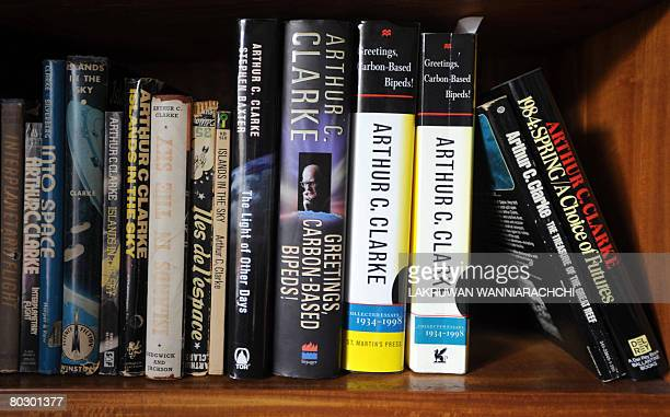 Books written by Britishborn science fiction author Arthur C Clarke stand on a shelf at his residence in Colombo on March 19 2008 Ninety year old...