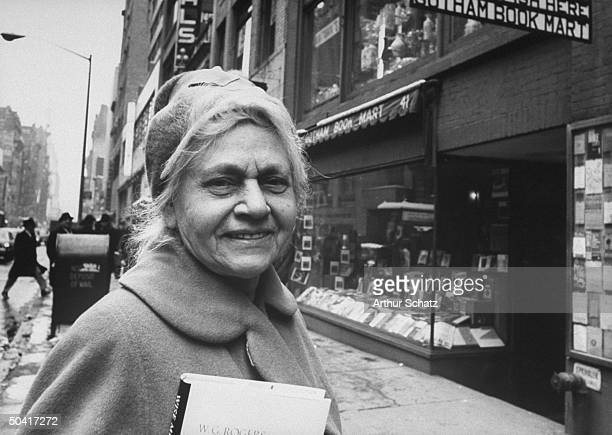 Bookseller and author Frances Steloff standing in front of her Gotham Book Mart