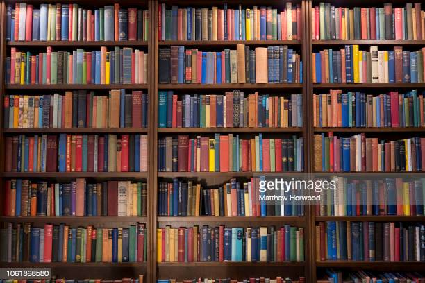 A bookshelf full of multicoloured books on October 28 2018 in Cardiff United Kingdom