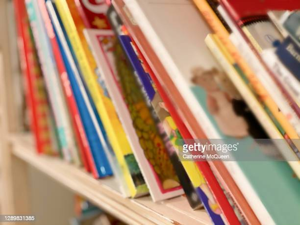 bookshelf loaded with children's books in toddler girl's bedroom - learning disability stock pictures, royalty-free photos & images
