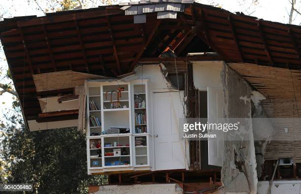 A bookshelf remains inside of a home that was destroyed by a mudslide on January 11 2018 in Montecito California 17 people have died and hundreds of...