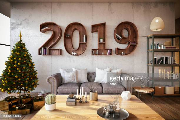 2019 bookshelf with cozy interior - vigilia di capodanno foto e immagini stock