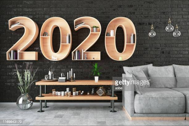 2020 bookshelf with cozy interior - 2020 stock pictures, royalty-free photos & images