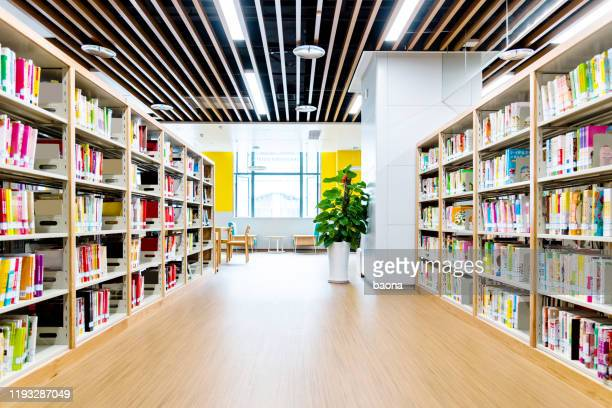 bookshelves in modern public library - library stock pictures, royalty-free photos & images