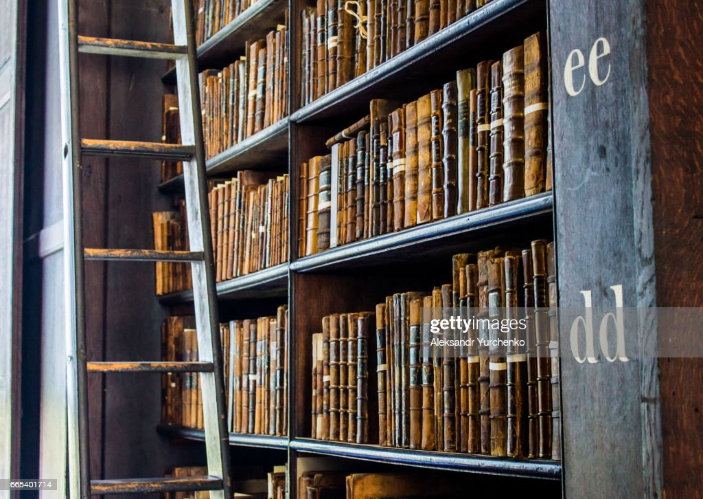 Bookshelves of an old library : Stock Photo