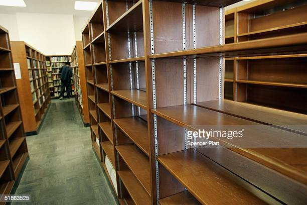 Bookshelves stand at the Brooklyn Public Library December 15 2004 in Brooklyn New York Google the internet search engine has announced a longterm...