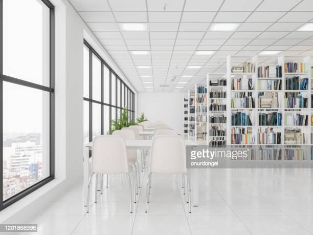 bücherregale, tische mit stühlen in der bibliothek - bibliothek stock-fotos und bilder
