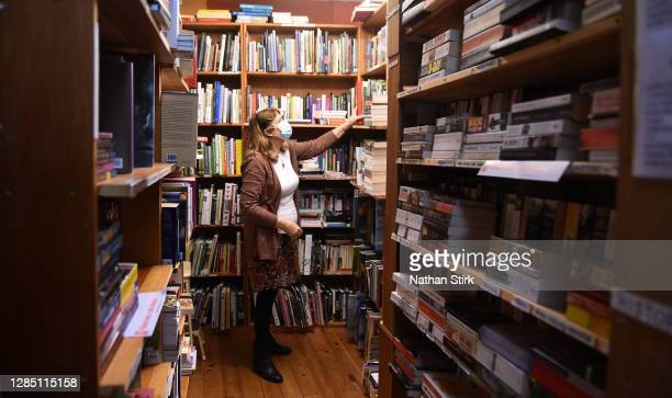 Bookshop owner is seen tidying her shop whilst closed during England's second lockdown in the Market Town of Leek on November 11, 2020 in Leek,...