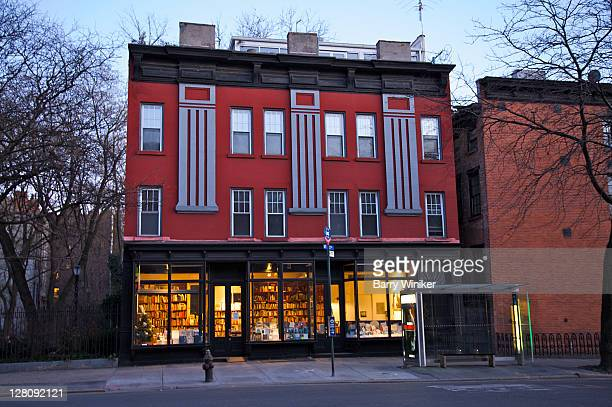 Bookstore at base of colorful building on 10th Avenue in Chelsea, New York, NY, USA