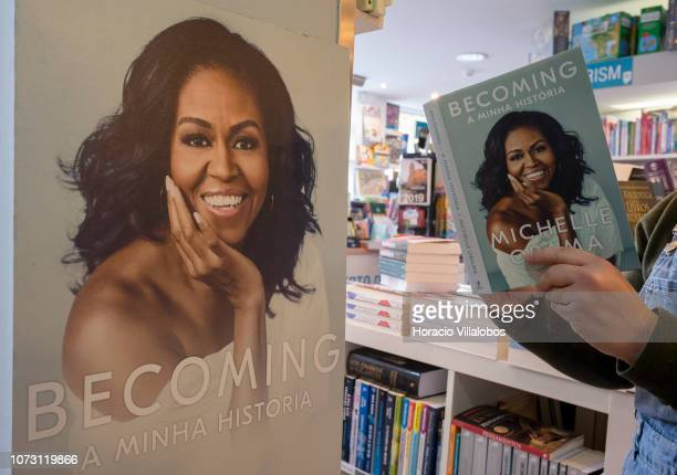 A bookstore employee holds a copy of the Portuguese edition of 'Becoming' a memoir by former US First Lady Michelle Obama at RG Livreiros bookstore...