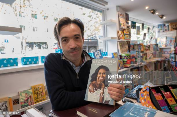 Bookstore owner Ricardo Gomes holds a copy of the Portuguese edition of 'Becoming' a memoir by former US First Lady Michelle Obama at the counter in...