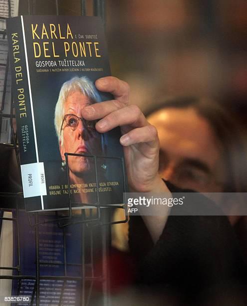 A bookstore vendor displays the memoirs of former UN chief war crimes prosecutor Carla Del Ponte �Madame Prosecutor� in Belgrade on November 26 2008...
