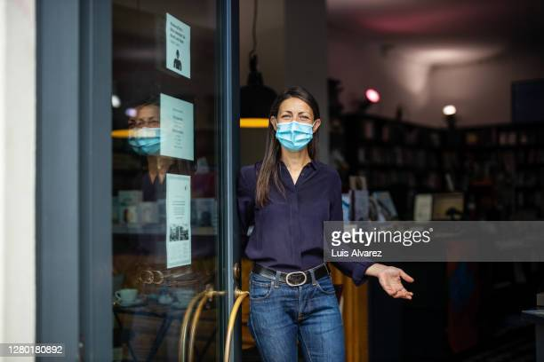 bookstore welcoming the customers post pandemic - gesturing stock pictures, royalty-free photos & images