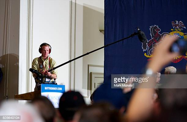 A boom operator records crowd sound as Republican Presidential candidate Mitt Romney greets supporters after holding a victory rally at Valley Forge...