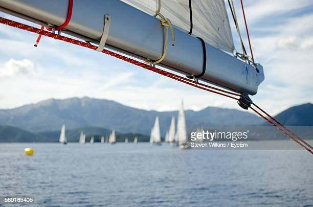 boom rope on sailboat at harbor - sail boom stock pictures, royalty-free photos & images