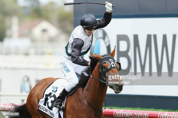 Boom Time ridden by Cory Parish celebrates after he wins the BMW Caulfield Cup during Melbourne Racing at Caulfield Racecourse on October 21 2017 in...